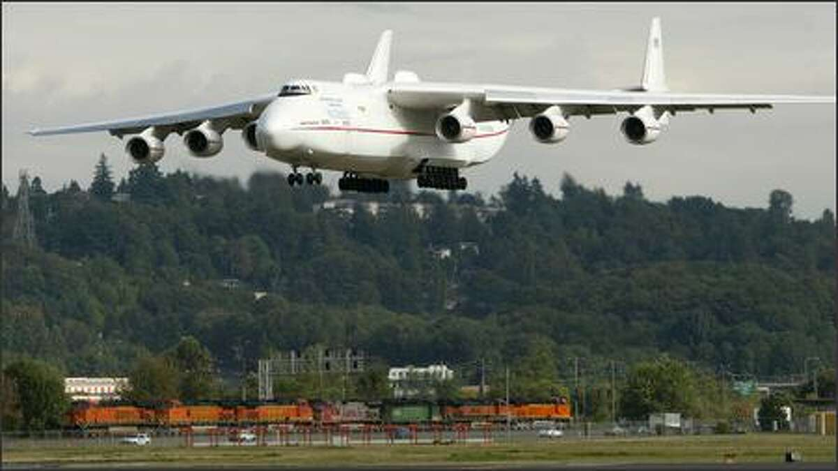 The world's biggest plane, the Russian-built Antonov An-225, landed at Boeing Field about 5 p.m. Friday after a flight from Rickenbacker cargo airport in Columbus, Ohio. The six-engine cargo plane delivered several General Electric engines for Boeing 777s that are now in production. The GE-90 engine for the 777 is the most powerful jet engine made today. Engines for Boeing's jetliners are delivered to Boeing Field because that's where the company's propulsion unit is located. The 777 engines will later be transported to Everett for attachment to the planes. The engines are normally flown to Boeing Field from the engine makers in smaller cargo planes.