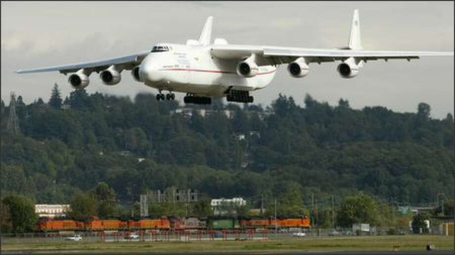 The world's biggest plane, the Russian-built Antonov An-225, landed at Boeing Field about 5 p.m. Friday after a flight from Rickenbacker cargo airport in Columbus, Ohio. The six-engine cargo plane delivered several General Electric engines for Boeing 777s that are now in production. The GE-90 engine for the 777 is the most powerful jet engine made today. Engines for Boeing's jetliners are delivered to Boeing Field because that's where the company's propulsion unit is located. The 777 engines will later be transported to Everett for attachment to the planes. The engines are normally flown to Boeing Field from the engine makers in smaller cargo planes. Photo: Joshua Trujillo, Seattlepi.com