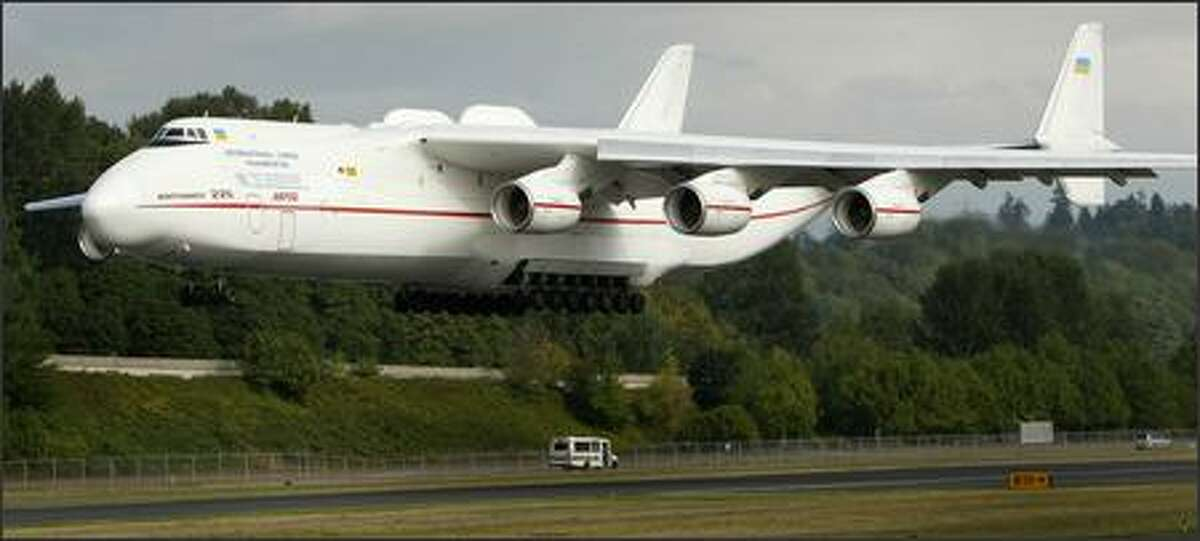 The Antonov An-225, the world's largest airplane, lands at Boeing Field in Seattle on Friday, August 31, 2007. The giant plane, with three engines under each wing, landed to pick up four 777 engines for a delivery.