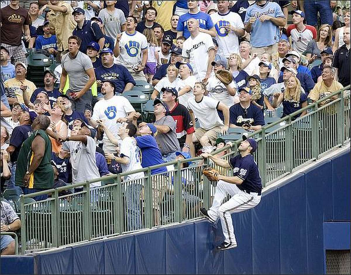 Milwaukee Brewers left fielder Ryan Braun goes after a foul ball hit by Houston Astros' Carlos Lee that went into the stands in the fourth inning of a baseball game in Milwaukee. (AP Photo/Milwaukee Journal Sentinel, Jack Orton)