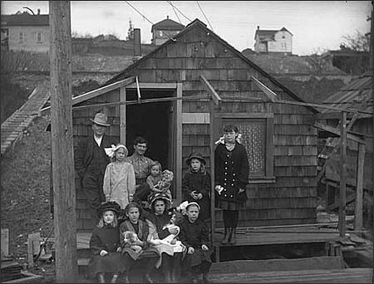 A family settles in downtown Ballard in 1910.