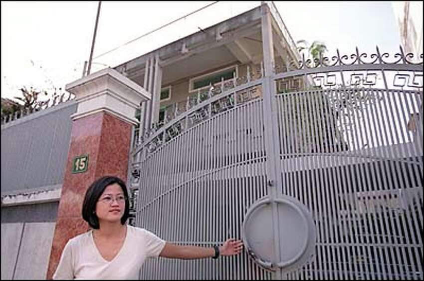 When the Communists North Vietnamese overthrew the government of South Vietnam in 1975 they seized homes and property, including the Le family home in Ho Chi Minh City. After a brief, tense visit with the new owners, Phuong Le closes the gate.