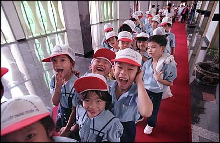 Ho Chi Minh City grade school children touring the Reunification Palace. Formerly known as Independence Place, it was the center of the government of South Vietnam during the Vietnam War, housing the President's office and the war command room which have been kept as they were when North Vietnamese tanks rolled onto the grounds April 30, 1975.
