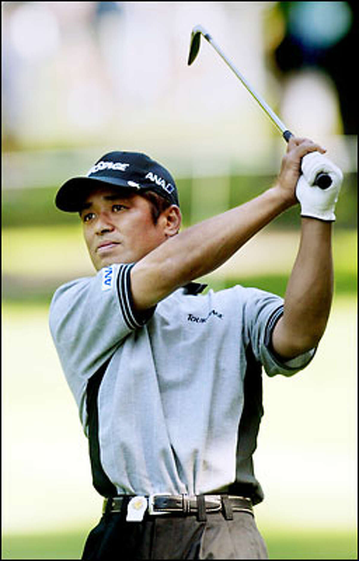Toshi Izawa of Japan watches his fairway shot on the 4th hole at the 2002 NEC Invitational at Sahalee Country Club in Sammamish. Izawa finished tied for first at 6 under par.