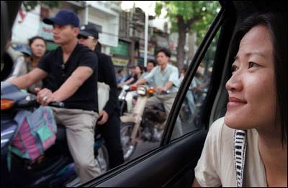 The streets along which Phuong Le's family fled from its home in Saigon in 1975 are clogged now with motorcycles from dawn until late at night. Photo: Paul Joseph Brown, Seattle Post-Intelligencer