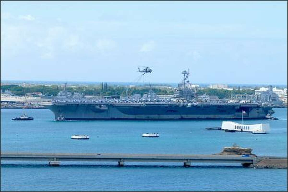 The Bremerton-based aircraft carrier USS John C. Stennis arrived in Pearl Harbor Monday, en route home from a seven-month deployment that took it to the Western Pacific and into the Persian Gulf near Iran, and earlier this month off Guam, participating in the largest joint military exercise in recent history, Navy officials said. (U.S. Navy photo by Mass Communication Specialist 3rd Class Paul J. Perkins)
