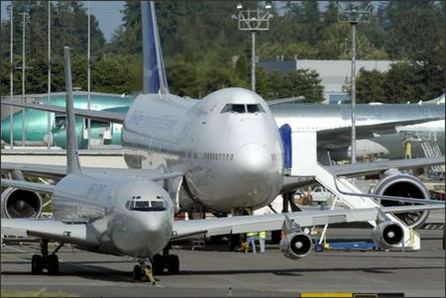 A Boeing 747-200 dwarfs the 707 Omega tanker as they wait at Everett's Paine Field before flying to Boeing Field in Seattle. Photo: Grant M. Haller, Seattle Post-Intelligencer