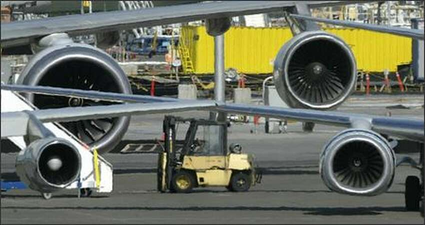 Jet engines, from lower left, clockwise: Boeing 707; Boeing 747 Rolls Royce Trent 1,000 (test model for the 787); the standard 747 engine; and the 737 engine.