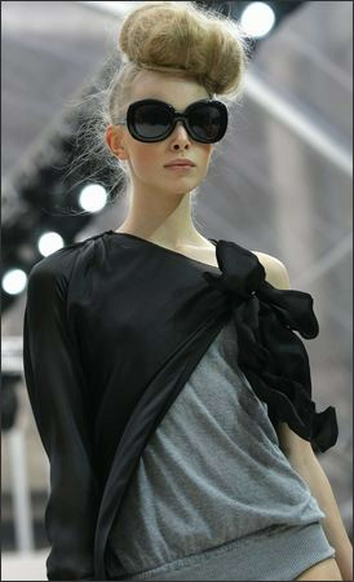 A model presents a creation by Rossella Jardini for Moschino.