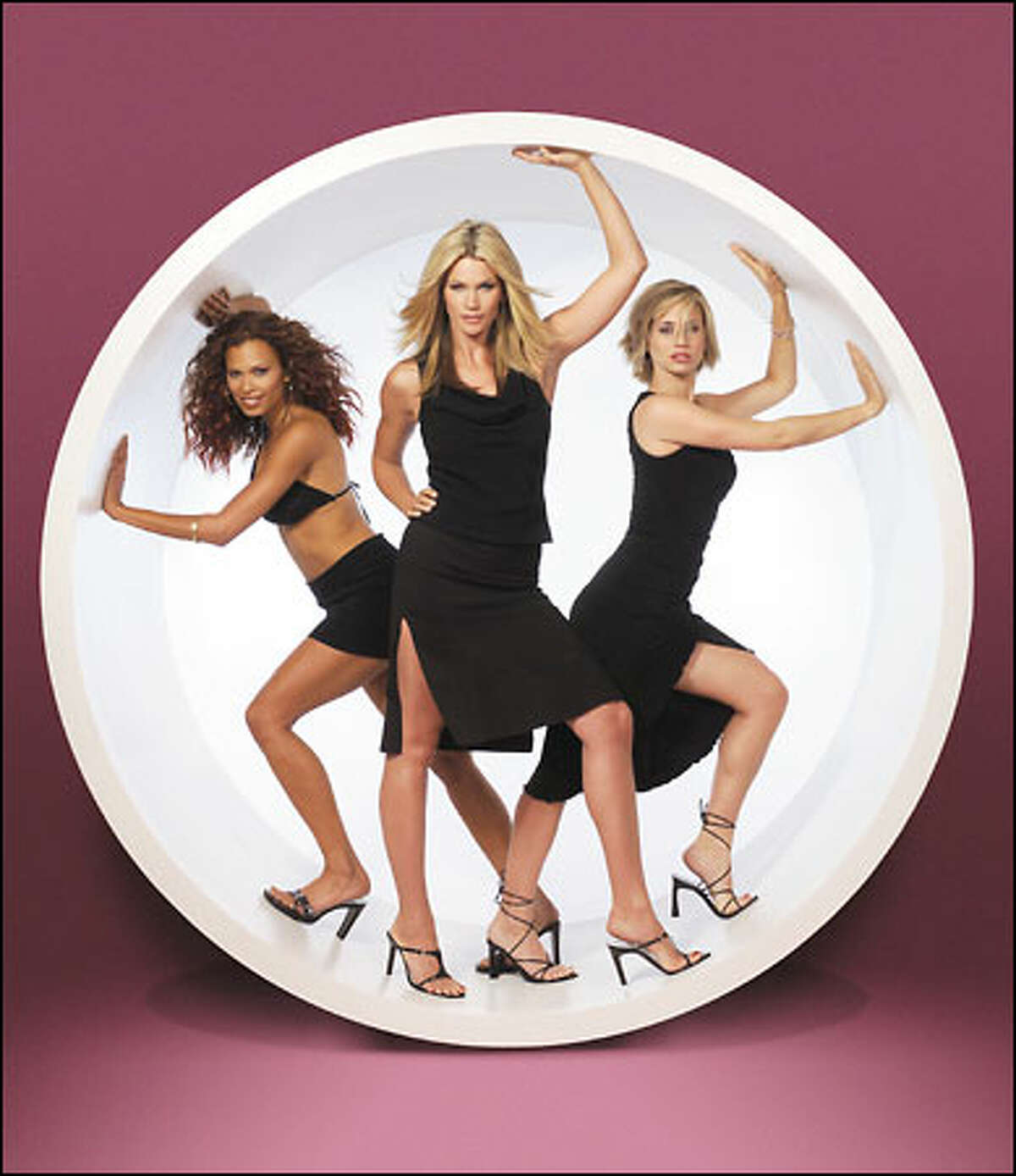 """In """"She Spies,"""" three gorgeous ex-cons are recruited to be special agents for the U.S. government. The series, which will move to syndication after debuting on NBC, stars (l-r) Natashia Williams as Shane, Natasha Henstridge as Cassie, Kristen Miller as DD."""