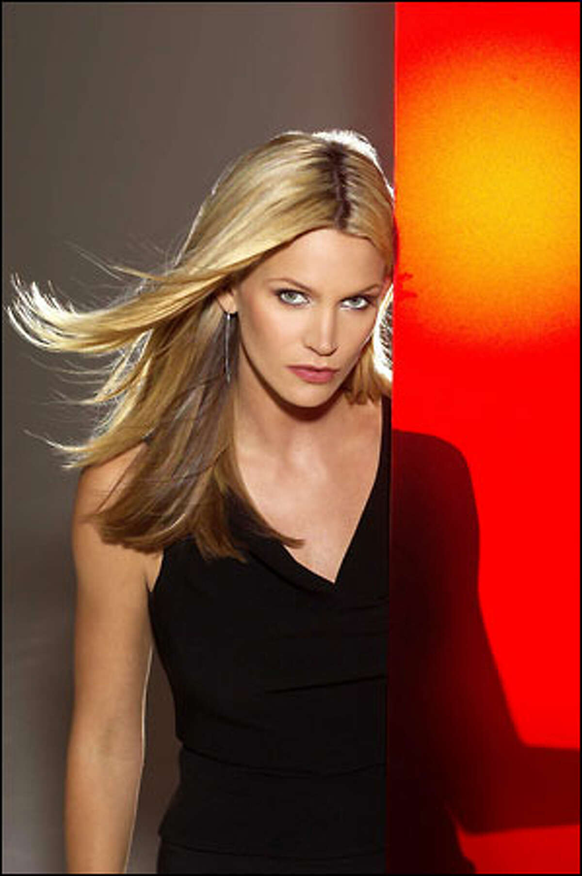 Natasha Henstridge plays Cassie, an elegant career con artist who ended up behind bars after a scheme backfired. The government gave her a choice: lead an elite trio of