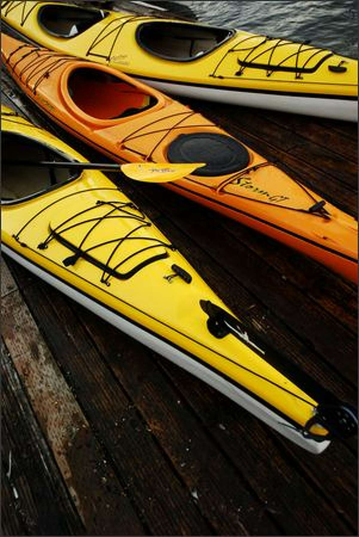 Kayaks from the Portland Kayak Company sit on a dock in Portland on July 9, 2007.