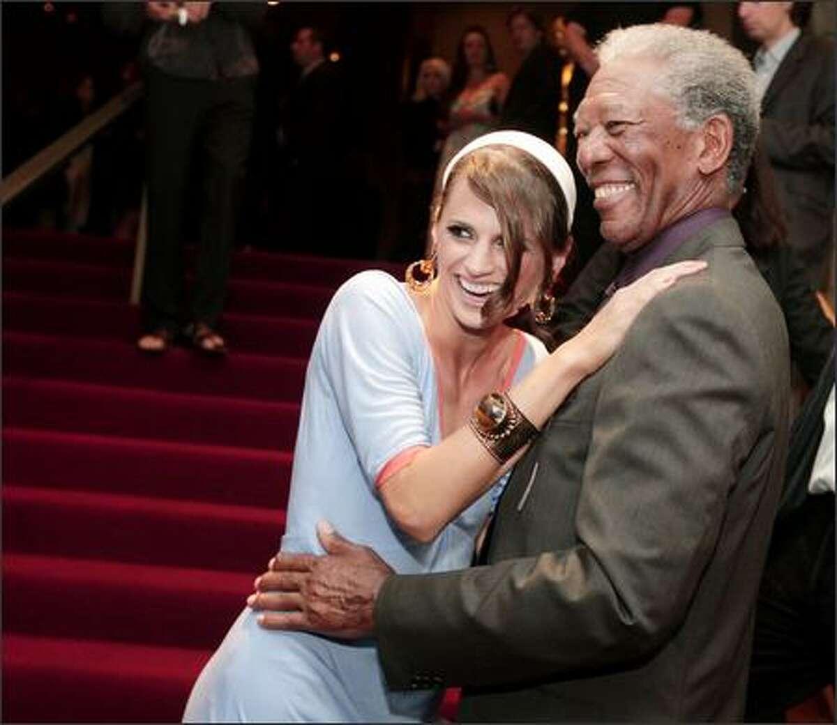 Actors Stana Katic (L) and Morgan Freeman talk at the premiere of MGM's