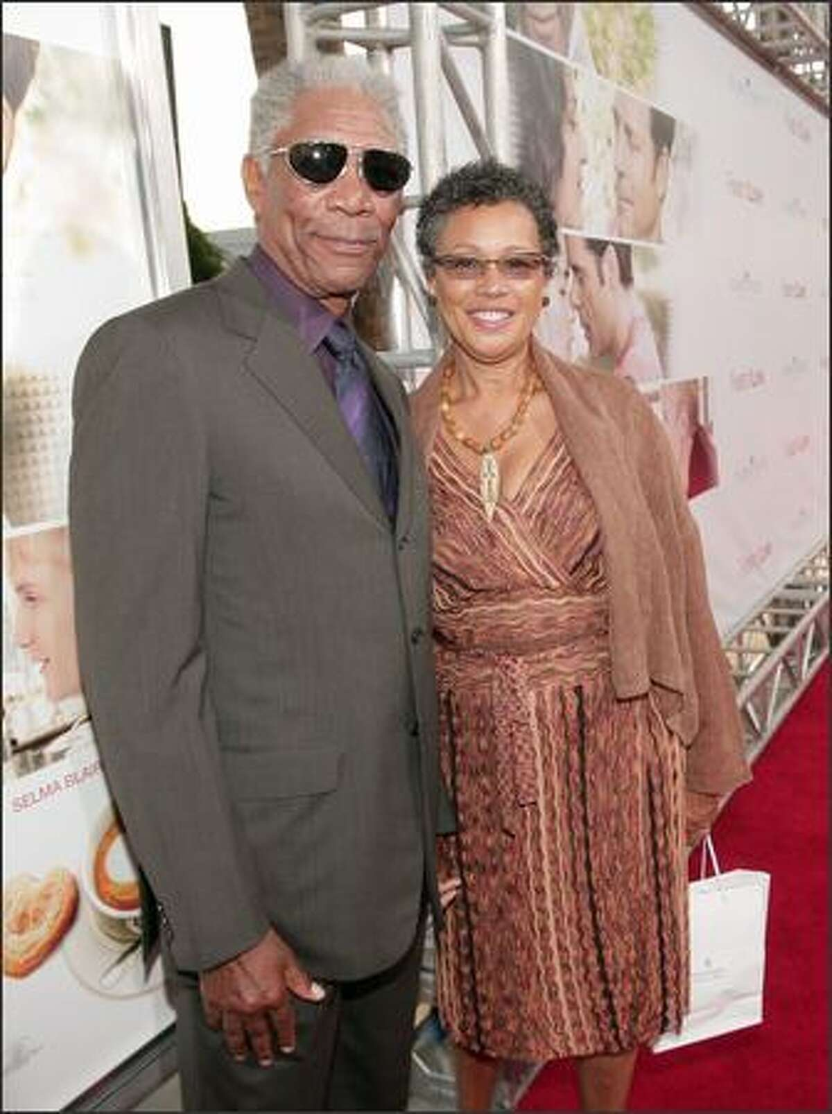 Actor Morgan Freeman (L) and his wife Myrna Colley-Lee arrive at the premiere of MGM's