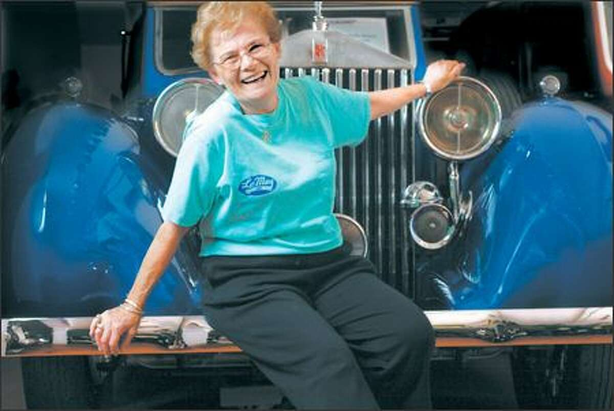 Nancy LeMay poses with a Rolls-Royce at her estate in Tacoma.