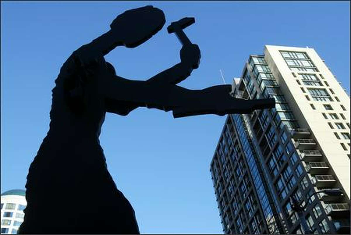 """Jonathan Borofsky's """"Hammering Man"""" in front of the Seattle Art Museum."""