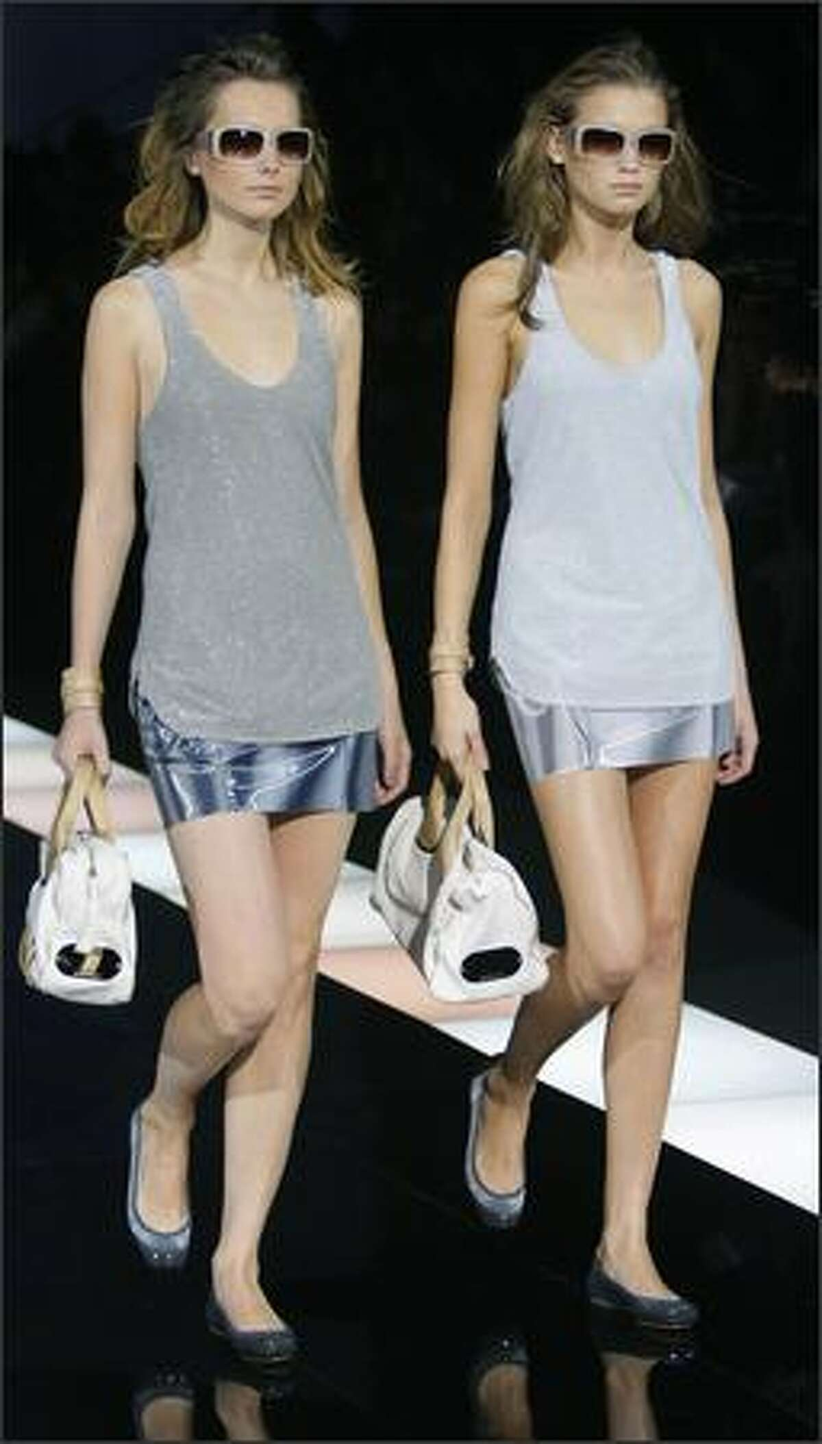 Model present creations by Italian designer Giorgio Armani for Emporio Armani during the Spring/Summer 2008 collections of the Milan ready-to-wear fashion shows.