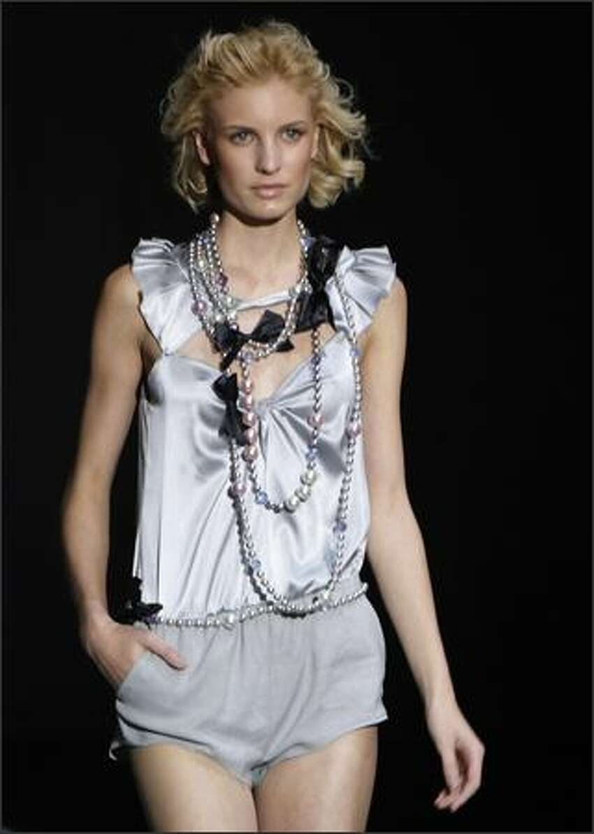 A model presents a creation by Italian designer Giorgio Armani for Emporio Armani during the Spring/Summer 2008 collections of the Milan ready-to-wear fashion shows.