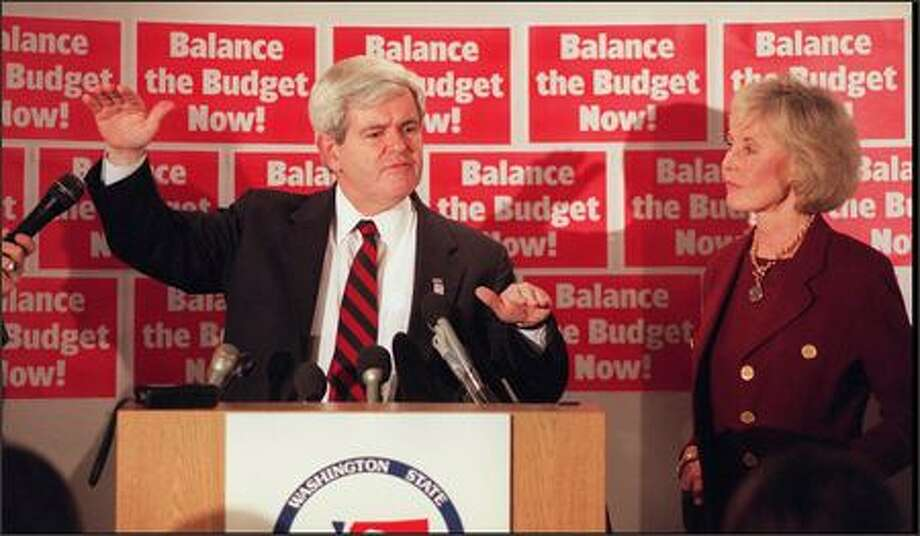Newt Gingrich addresses a press conference before a rally at the Doubletree Suites Hotel at Southcenter, with Washington's U.S. Congresswoman Jennifer Dunn at his side. Photo: P-I File