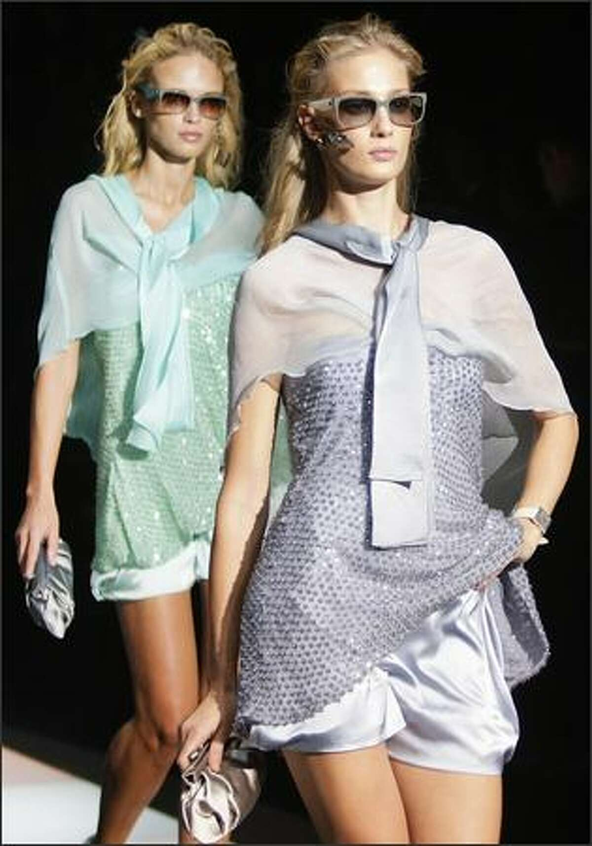 Models present creations by Italian designer Giorgio Armani for Emporio Armani during the Spring/Summer 2008 collections of the Milan ready-to-wear fashion shows.