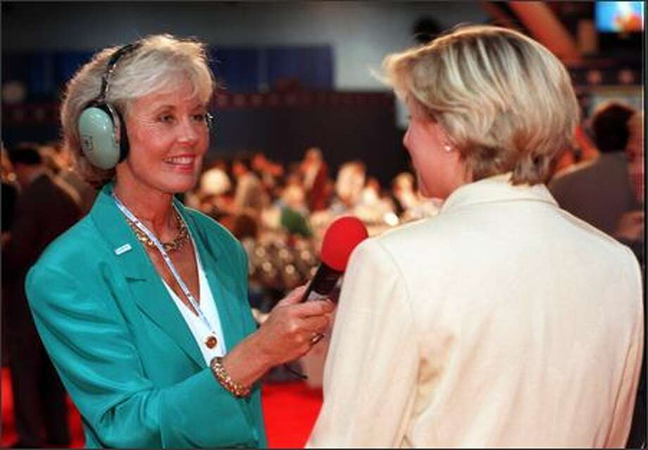 Jennifer Dunn of GOP TV, left, does a sound check with GOP TV producer Kimberly Rimmer on the floor of the Republican National Convention on Aug. 14, 1996, in San Diego. (Denis Poroy/Associated Press File) Photo: P-I File