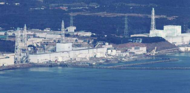 Fukushima Dai-ichi nuclear power plant is pictured before helicopters dump water on the stricken reactor to cool overheated fuel rods inside the core in Okumamachi, Fukushima Prefecture, Japan, Thursday morning, March 17, 2011. (AP Photo/Kyodo News) JAPAN OUT, MANDATORY CREDIT, NO LICENSING IN CHINA, HONG KONG, JAPAN, SOUTH KOREA AND FRANCE