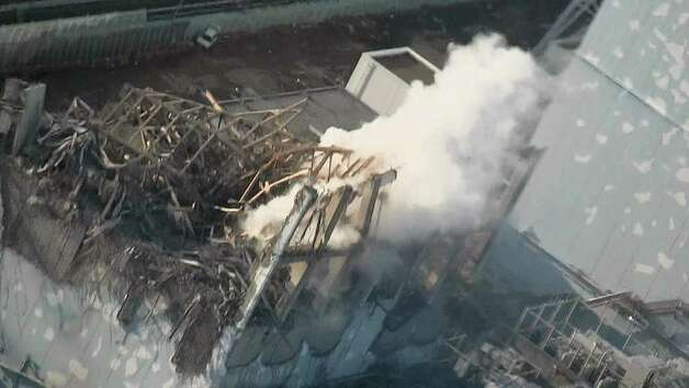 In this photo released by Tokyo Electric Power Co. (TEPCO), thick while smoke billows from the No. 3 unit of the Fukushima Dai-ichi nuclear power plant in Okumamachi, Fukushima Prefecture, Thursday afternoon, March 17, 2011. A nearly completed new power line could restore cooling systems in Japan's tsunami-crippled nuclear power plant, its operator said Thursday, raising some hope of easing the crisis that has threatened a meltdown and already spawned dangerous radiation surges. (AP Photo/Tokyo Electric Power Co.) EDITORIAL USE ONLY, NO SALES