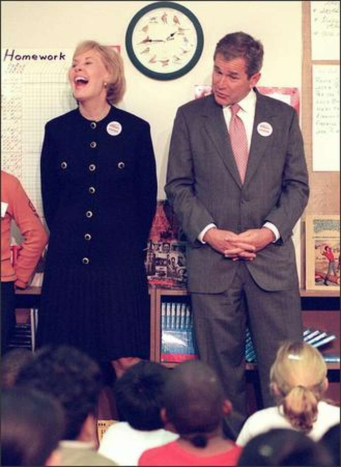 Congresswoman Jennifer Dunn reacts to a question asked of presidential candidate George W. Bush, right, by a student at Kimball Elementary School on Oct. 10, 1999. (Rick Giase/Associated Press File) Photo: P-I File