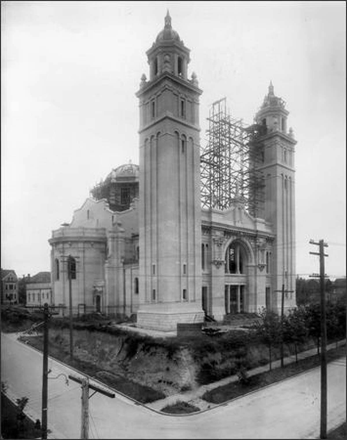 Since its dedication in 1907, the towers of St. James Cathedral, shown here under construction, have stood out above Seattle's downtown. When plans for the cathedral, to be built in the Italian Renaissance style, were first announced by Bishop Edward O'Dea in the late 1890s, there were few Catholics in the city. After 38 years, the original cost of and $300,000 in interest was paid off. In 1950, the cathedral was completely renovated.