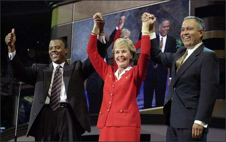 The three deputy permanent co-chairpersons of the Republican National Convention, from left, Reps. J.C. Watts of Oklahoma, Jennifer Dunn of Washington and Henry Bonilla of Texas, join hands at the Republican National Convention in Philadelphia on Aug. 3, 2000. (Charles Rex Arbogast/Associated Press File) Photo: P-I File