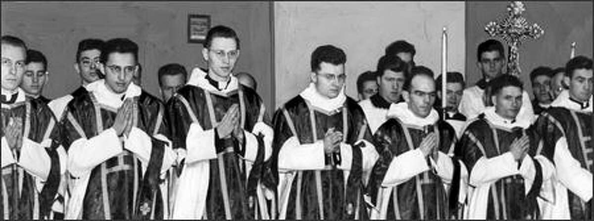 This was one of the colorful and solemn rituals at St. James Cathedral in Seattle on Sunday December 19, 1943, when the Rev. John Duffy of Vancouver, Wash., was ordained to the holy priesthood and seven other seminarians from St. Edward's Seminary, Kenmore, were ordained to the sacred order of subdeaconship. Most Reverend Bishop Gerald Shaughnessy S. M., officiated at the ordination.