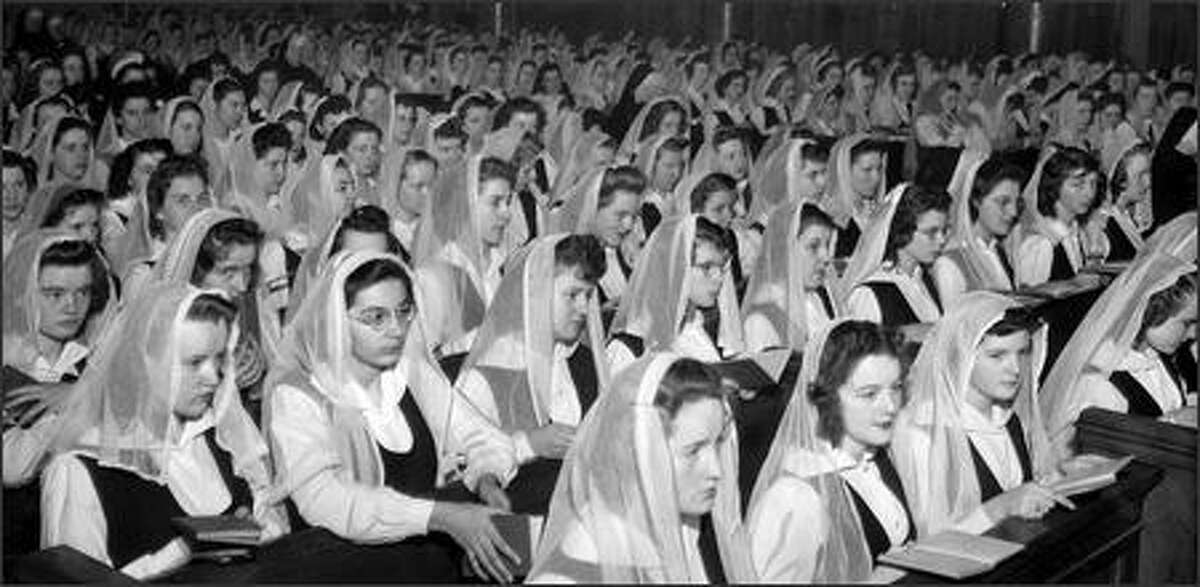 A choir of 500 voices composed of students is shown at St. James Cathedral in Seattle on December 17, 1944 at a centenary celebration of the founding of the Sisterhood of Holy Names.