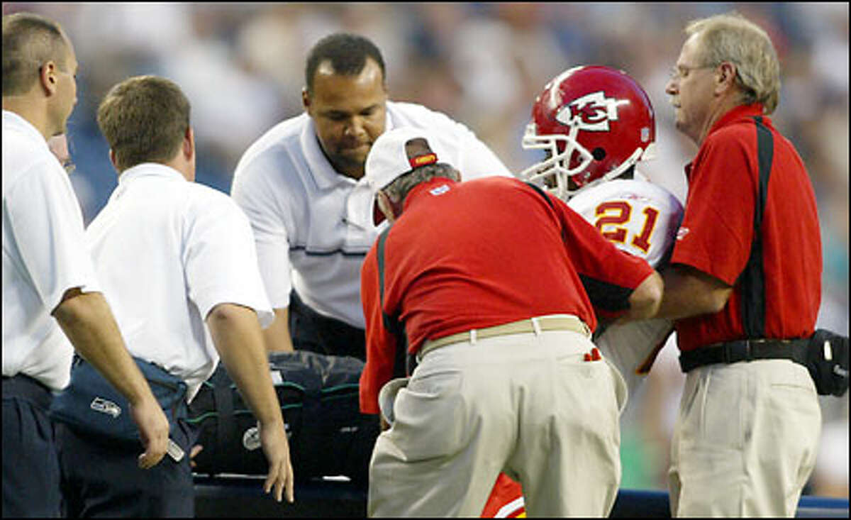 Kansas City Chiefs free safety Jerome Woods is lifted onto a cart after breaking his right leg during the second quarter of an exhibition game against the Seattle Seahawks. Woods will be out for the season, coach Dick Vermeil said after the game.