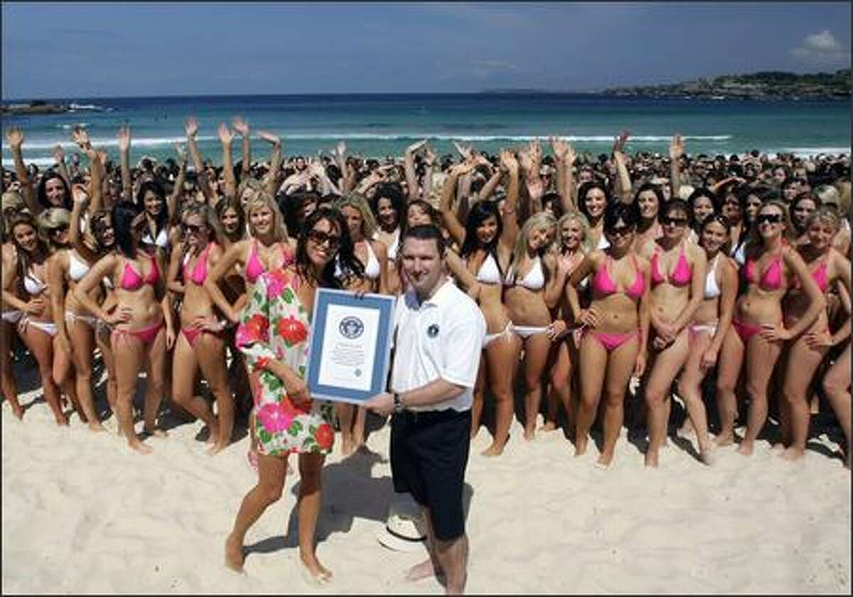 Cosmopolitan magazine editor Sarah Wilson and Guinness World Record Adjudicator Chris Sheedy pose during the world record attempt for the biggest swimsuit photo shoot at Bondi Beach on September 26, 2007 in Sydney, Australia. Australia's Cosmopolitan magazine and Venus Breeze joined forces to break the Guinnesss World Record for the Biggest Swimsuit Shoot, as more than 1010 bikini clad women attended the shot to celebrate 30 days of Fashion and Beauty.