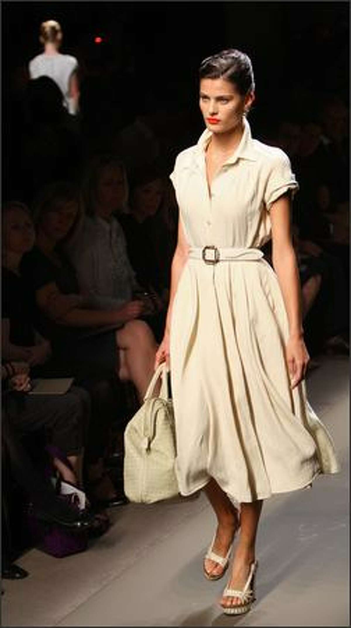 A model presents a creation by Bottega Veneta.