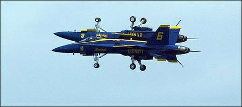 U.S. Navy Blue Angels 5 (inverted) and 6 fly over Lake Washington during their performance.