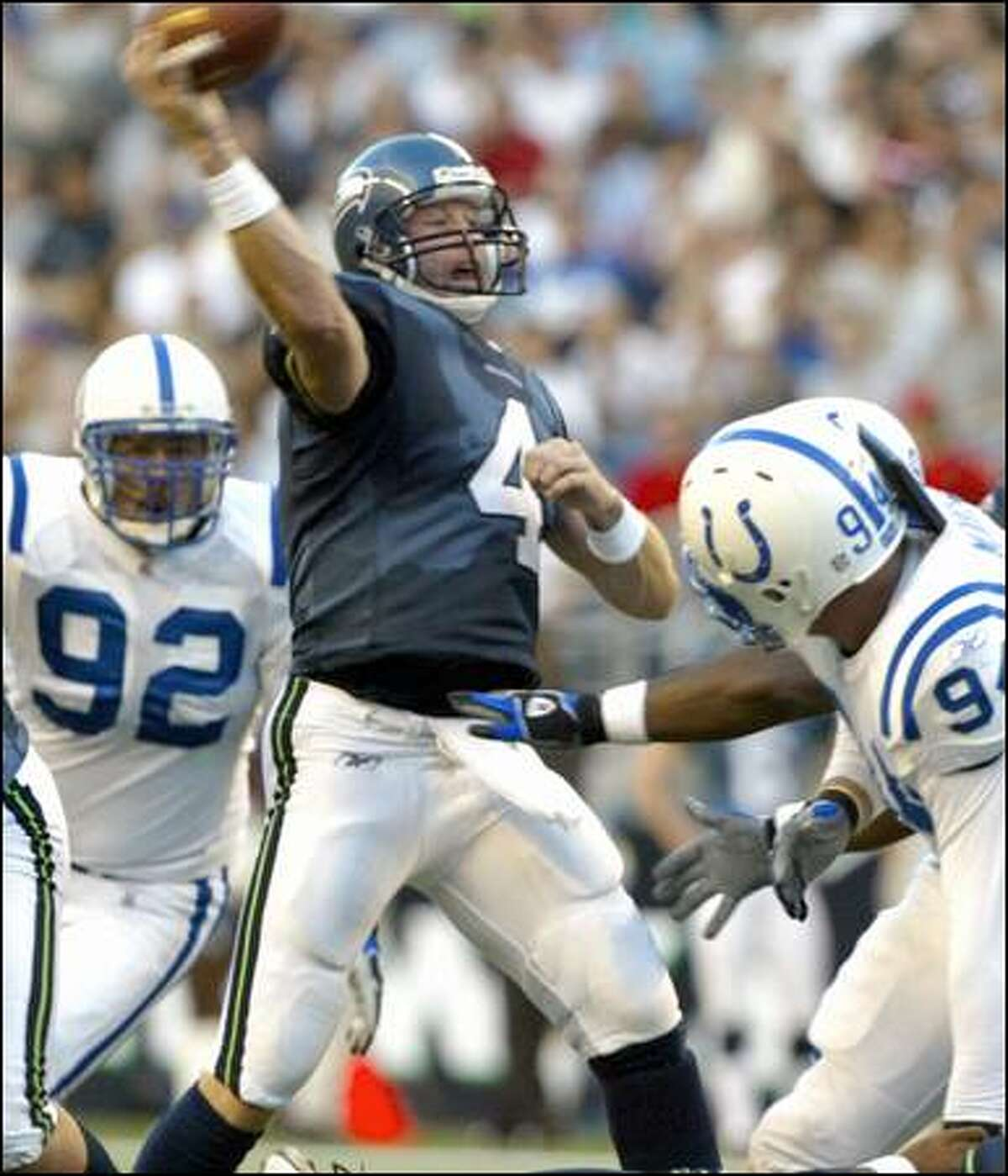 Trent Dilfer throws a pass in the first quarter before his injury.