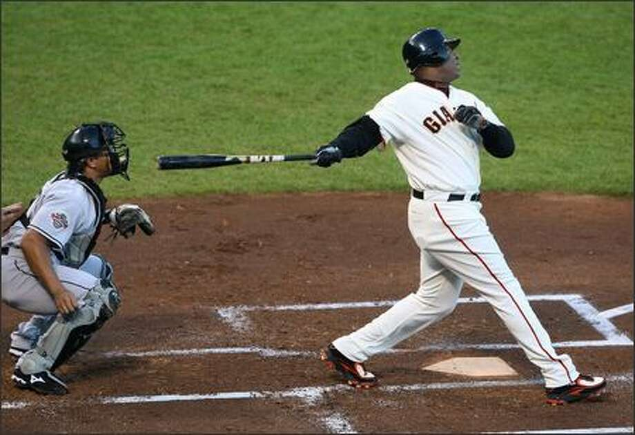 Barry Bonds #25 of the San Francisco Giants watches the flight of his ball as he hits career home run number 754 during the first inning against the Florida Marlins at AT&T Park July 27, 2007 in San Francisco, California. Photo by Justin Sullivan/Getty Images