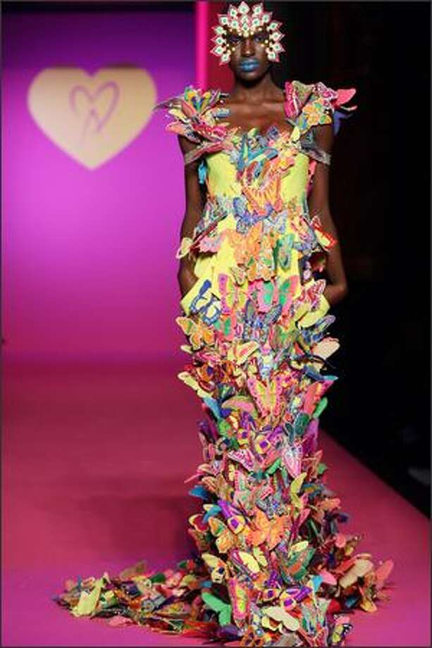 A model presents a creation by Indian designer Manish Arora during the Spring/Summer 2008 ready-to-wear collection show in Paris, 30 September 2007. AFP PHOTO FRANCOIS GUILLOT Photo: Getty Images