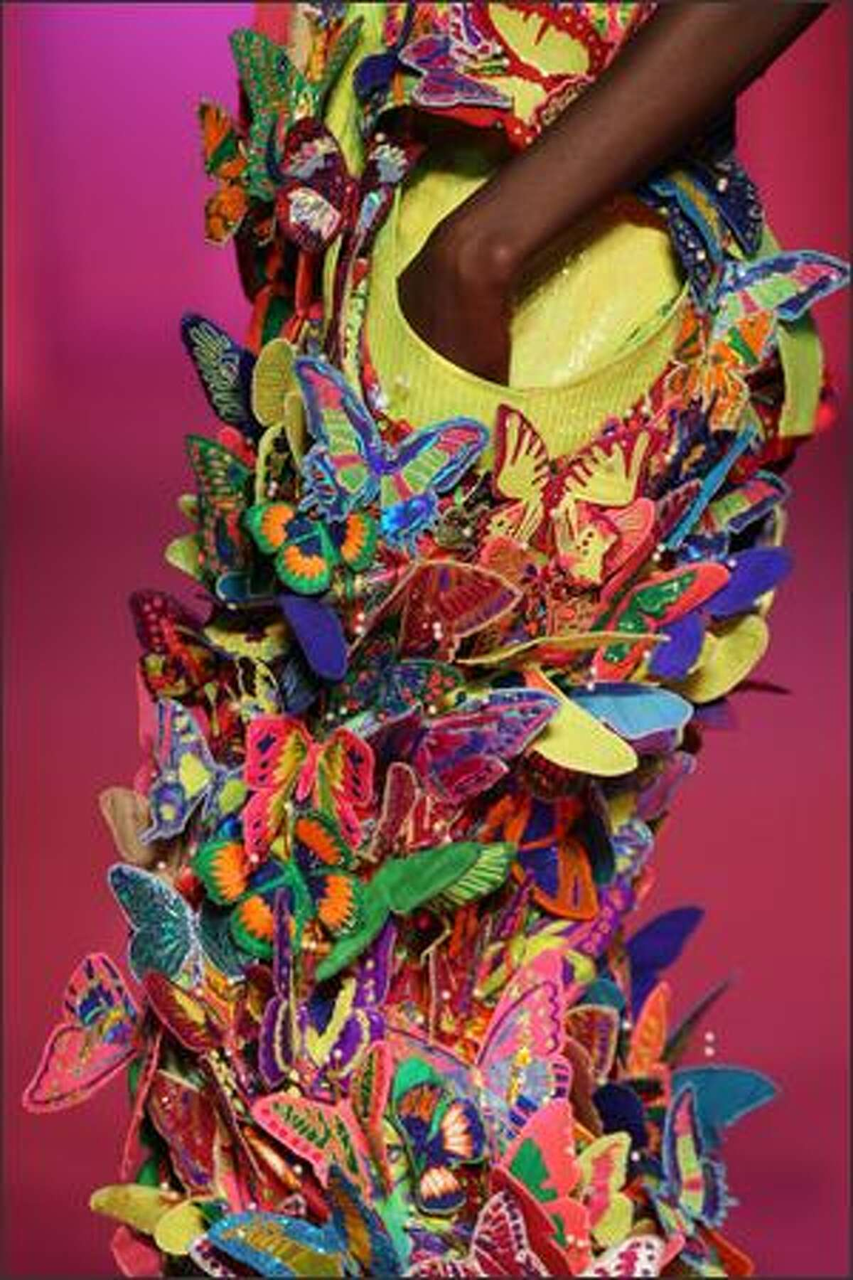 A model presents a creation by Indian designer Manish Arora during the Spring/Summer 2008 ready-to-wear collection show in Paris, 30 September 2007. AFP PHOTO FRANCOIS GUILLOT