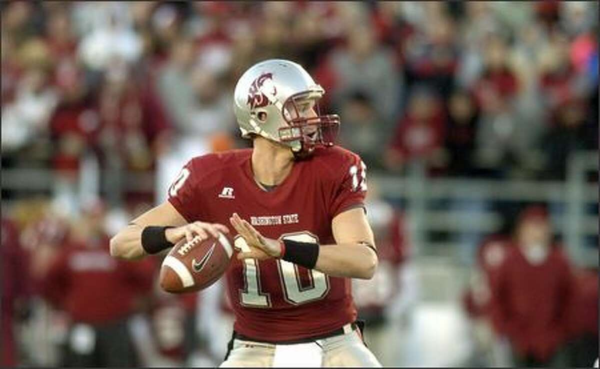Washington State quarterback Alex Brink picks out a receiver in the first half. Washington State won 33-17 and Brink broke the school record for career touchdown passes with 71. (AP Photo/Joe Barrentine)