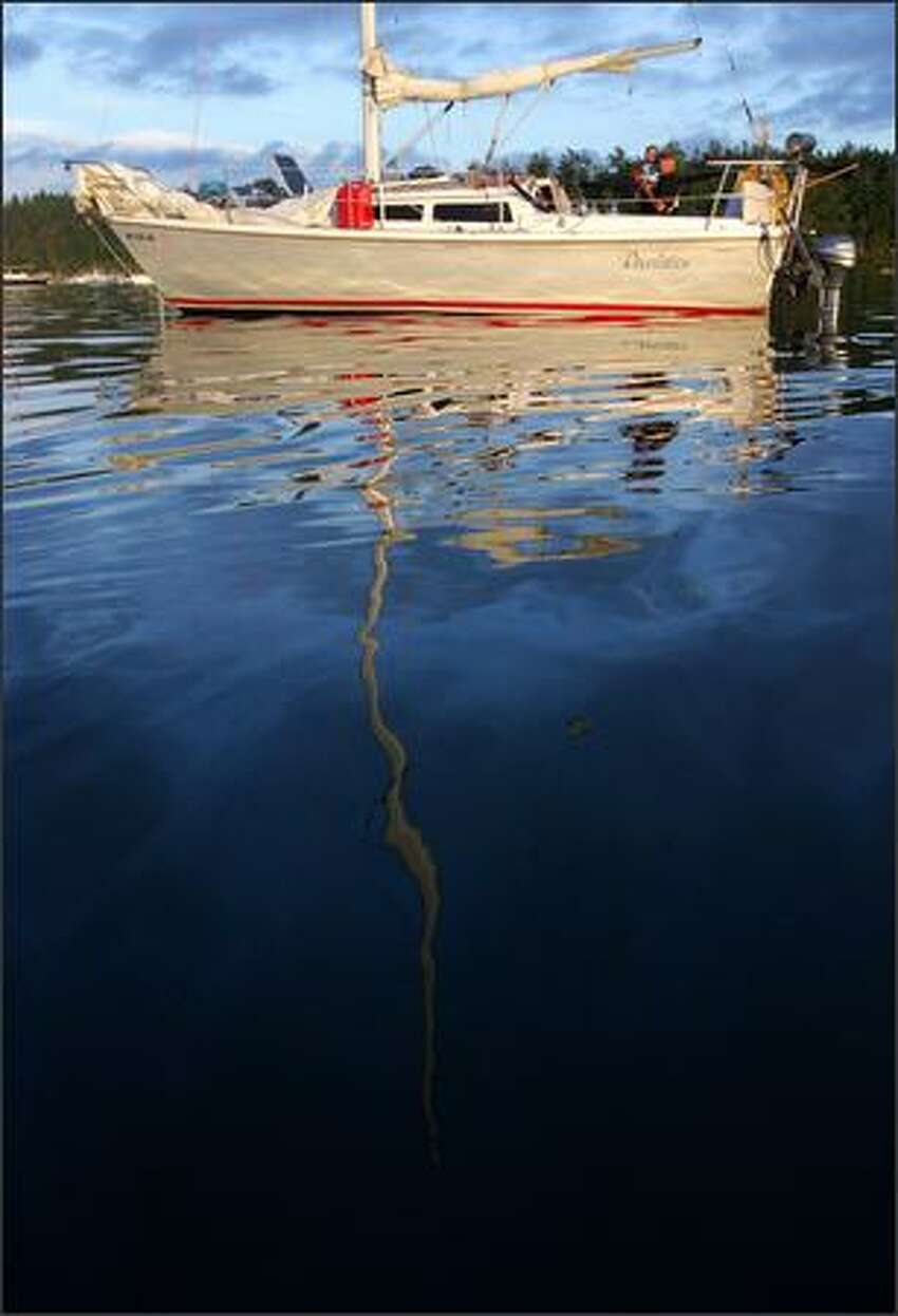 A sailboat at anchor in Roche Harbor, one of the few fuel and food stops for boats in the northern San Juan Islands.