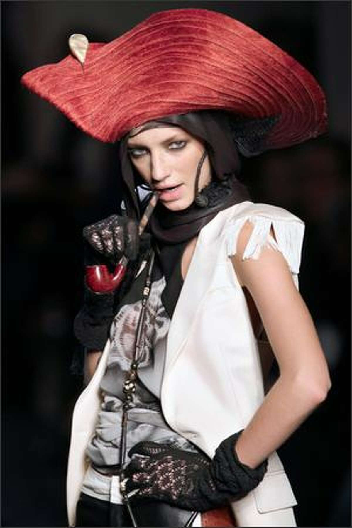 A model presents a creation by French designer Jean-Paul Gaultier during the Spring/Summer 2008 ready-to-wear collection show in Paris.
