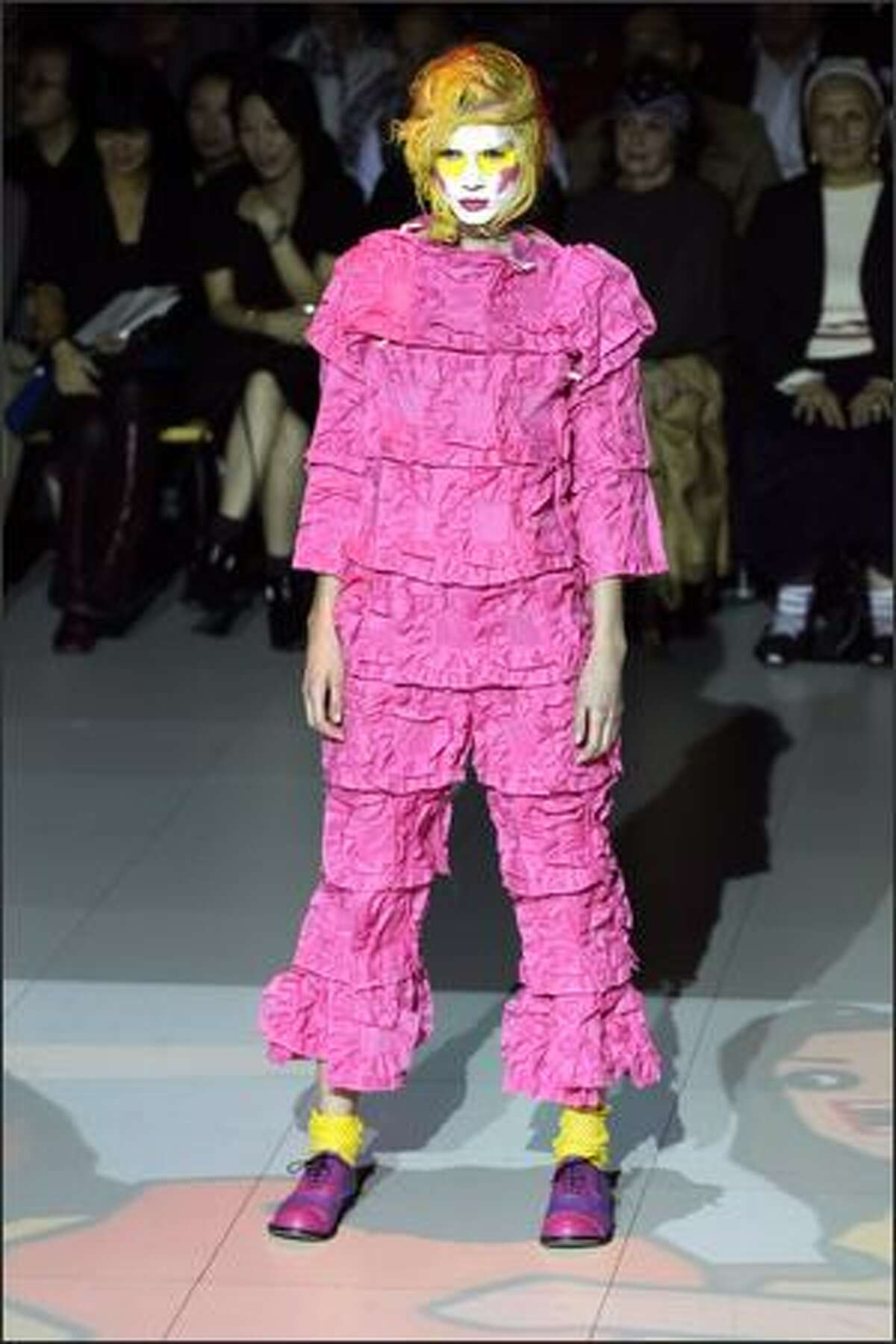 A model presents a creation by Comme des Garcons during the Spring/Summer 2008 ready-to-wear collection show in Paris.