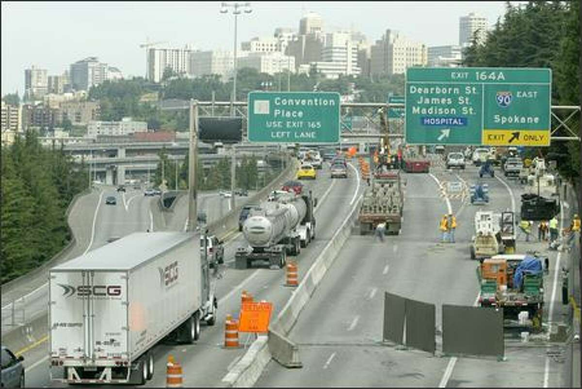 Northbound traffic is squeezed down to two lanes for construction crews to work on the surface of the north lanes before repaving can be completed between Spokane Street and the I-90 exit.