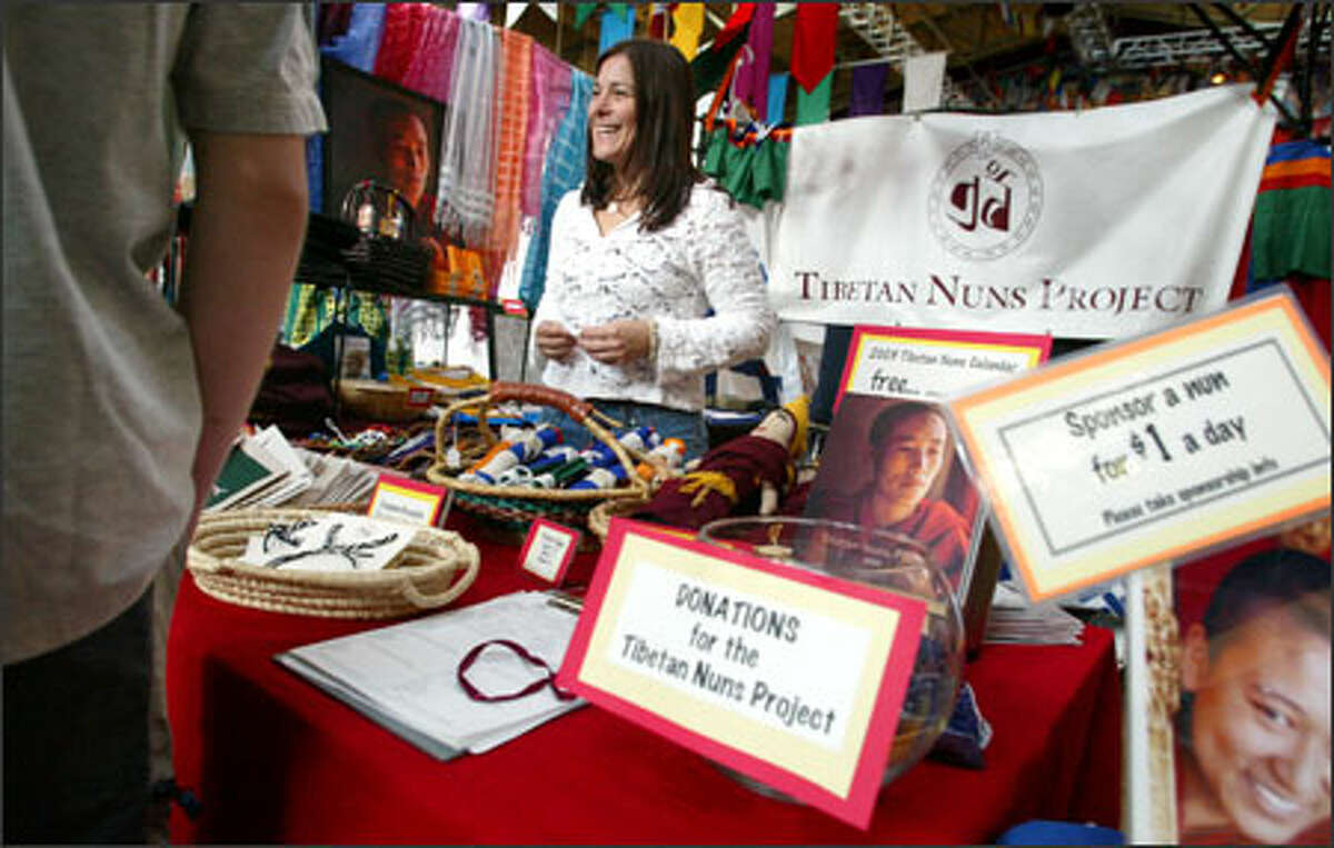 Debra Goldman, development officer for the Seattle-based Tibetan Nuns Project, sells handmade goods Sunday at the Tibet Festival at the Seattle Center. The project supports 600 Buddhist nuns in exile.