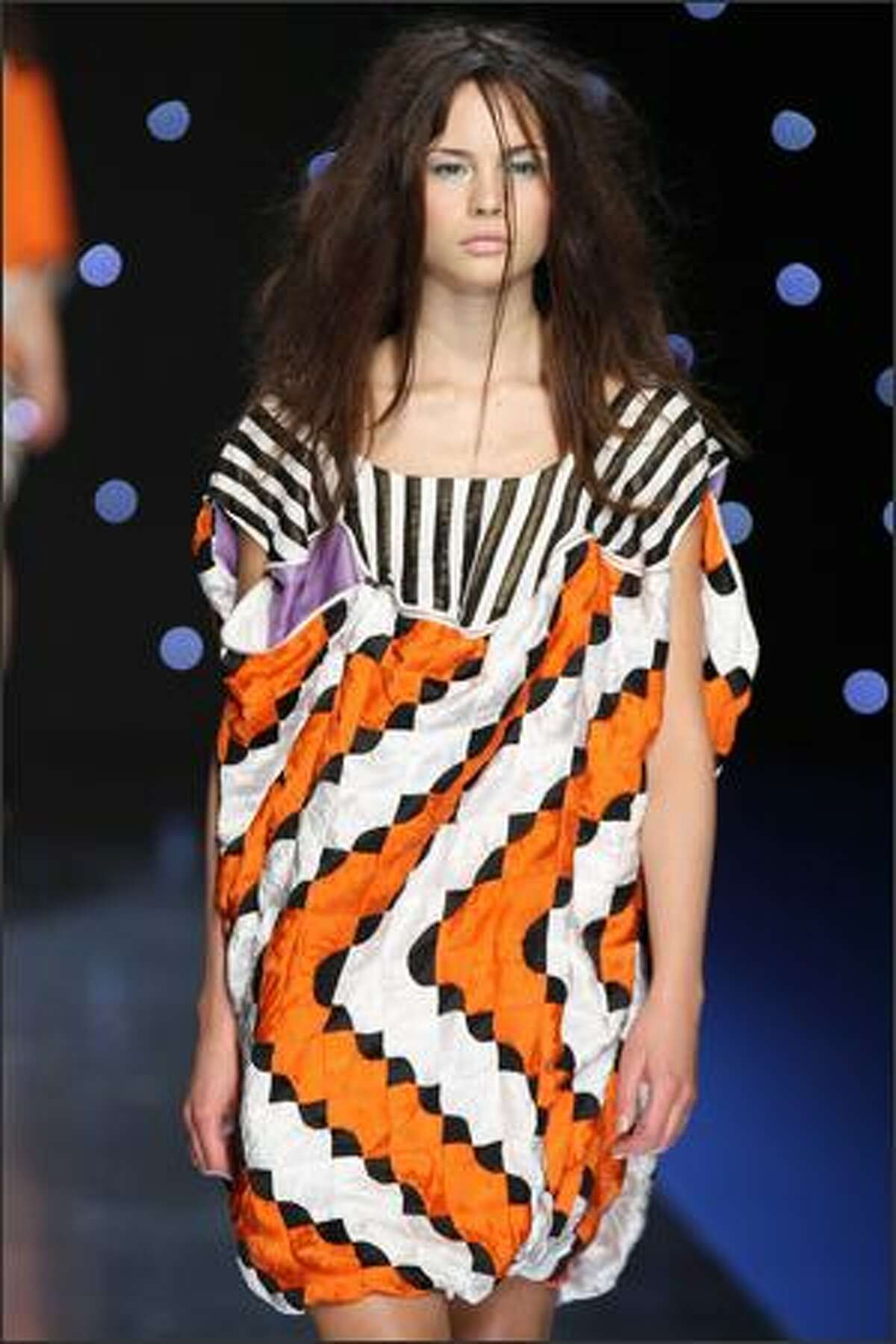 A model presents a creation by Japanese designer Tsumori Chisato during the Spring/Summer 2008 ready-to-wear collection show in Paris.