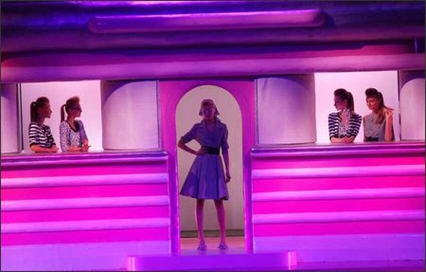 Models present creations by Italian designer Anna Molinari for Blugirl.