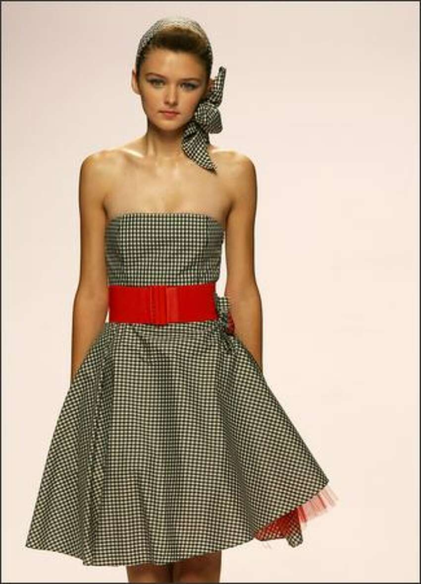 A model presents a creation by Italian designer Anna Molinari for Blugirl.