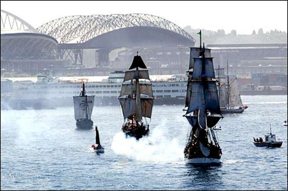 The Lady Washington, a brig, the Hawaiian Chieftan, a square topsail ketch, and La Nina, a reproduction of Christopher Columbus' famed 15th century caravel, parade in front of Safeco Field and Seahawks Stadium yesterday. Photo: Meryl Schenker, Seattle Post-Intelligencer
